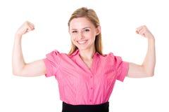 Fuerza joven y potencia de las demostraciones de la hembra, aisladas Foto de archivo