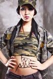 Fuerza modelo asiática, pelo negro largo, labios foto de archivo