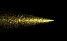 Fuga de brilho da poeira de estrela do ouro abstrato das partículas Fotografia de Stock Royalty Free