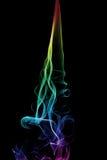 Fuga do fumo do arco-íris no fundo preto fotografia de stock royalty free