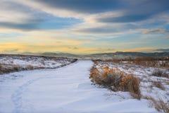 Fuga nevado no por do sol Imagem de Stock Royalty Free