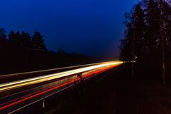 Fugas da luz do tráfego da estrada Fotos de Stock