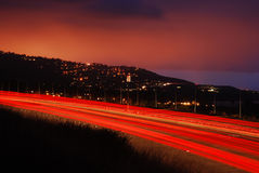 Fugas da luz no crepúsculo Fotografia de Stock Royalty Free