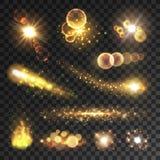 Fugas e flashes efervescentes dourados da luz Foto de Stock