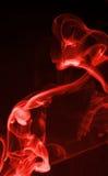 Fugas vermelhas do fumo imagem de stock royalty free
