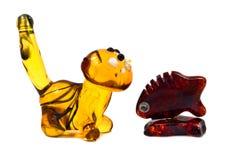 Fugures of Baltic amber on white background Stock Image