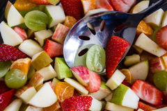 Fuit Salad Being Mixed with Spoon Stock Photos