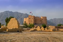 Fujairah fort. With a view of ancient village ruins.This fort was built from local materials involving stone, gravel, clay, hay, and gypsum royalty free stock images