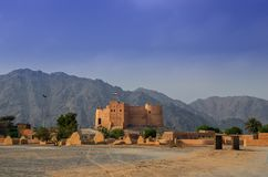 Fujairah fort. With a view of ancient village ruins.This fort was built from local materials involving stone, gravel, clay, hay, and gypsum royalty free stock photography