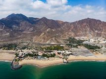 Fujairah sandy beach in the United Arab Emirates. Aerial view uae sea seaside above water sharjah travel tourist destination mountain rock arid desert sandstone royalty free stock image
