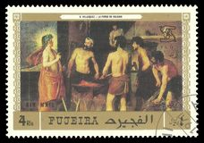 The Forge of Vulcan by Diego Velazquez. Fujeira - stamp 1971: Color edition on Art, shows Painting The Forge of Vulcan by Diego Velazquez Stock Image