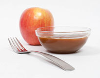 Fuji Apple with Caramel. And fork royalty free stock photography
