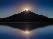 Fuji diamond , Sunset on Top of Mountain Fuji and refection at Lake Yamanakako Royalty Free Stock Images