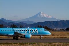 FUJI DREAM AIRLINES ERJ 170. FUJI DREAM AIRLINES Embraer ERJ-170 Taked At FUJISAN SHIZUOKA AIRPORT JA02FJ Royalty Free Stock Image