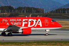 FUJI DREAM AIRLINES ERJ 170. FUJI DREAM AIRLINES Embraer ERJ-170 Taked At FUJISAN SHIZUOKA AIRPORT JA01FJ With Tea plantation Stock Images