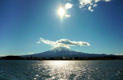 Fuji from Kawaguchigo lake. Fuji from Kawaguchiko lake with the sun reflexing to the lake at noon Royalty Free Stock Photos