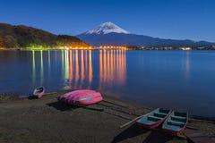 Fuji Lake Kawaguchiko at Night. Fuji Mountain and Boat at Night stock images
