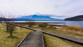 Fuji mount with snow on top in spring time at Yamanaka lake Royalty Free Stock Images