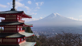 Fuji mountain behind red pagoda temple Stock Images