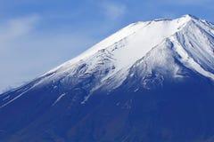Fuji Mountain at lake Kawaguchi, Japan. Fuji Mountain with snow cap at lake Kawaguchi, Japan. With hiking trail visible between the snow stock photo