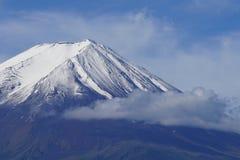 Fuji Mountain at lake Kawaguchi, Japan. Fuji Mountain with snow cap at lake Kawaguchi, Japan. With hiking trail visible between the snow royalty free stock photography