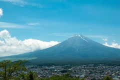 Fuji mountain with nice blue sky which viewing from Shimoyoshida Pagoda stock photography