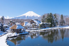 Fuji mountain from Oshino village. Fuji mountain view from 1 of 8 pond at Oshino village,Japan. After snow storm in March royalty free stock images