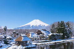 Fuji mountain from Oshino village. Fuji mountain view from 1 of 8 pond at Oshino village,Japan. After snow storm in March stock photos