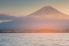 Fuji mountain over Kawaguchiko water lake, Japan. Natural landscape background Royalty Free Stock Images