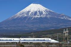 Fuji Mountain and Shinkansen Bullet Train. Tokaido Shinkansen run between tokyo and Osaka with fuji mountain background Stock Images