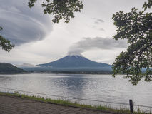 Fuji Mountain with storm clouds and lake Kawaguchiko, Yamanashi Japan.  Royalty Free Stock Images