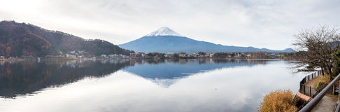 Fuji mountain under cloudy sky. Panorama view of Fuji mountain with surrounding view under cloudy sky in Japan Royalty Free Stock Images