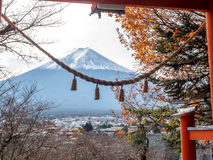 Fuji mountain under cloudy sky. Fuji mountain with sacred gate (Torei) foreground in Japan Stock Photography