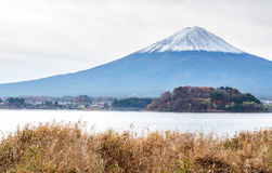 Fuji mountain under cloudy sky. Fuji mountain with surrounding view under cloudy sky in Japan Stock Photo