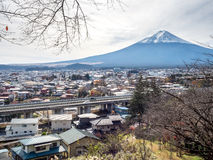 Fuji mountain under cloudy sky. Fuji mountain with surrounding view under cloudy sky in Japan Royalty Free Stock Photos