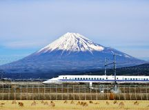 Fuji and Train. A bullet train passes below Mt. Fuji in Japan Stock Images