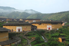 Fujian Tulou. Chuxi Tulou clusterr, In the right is largest round tulou, and also the oldest in this cluster. It consists of two concentric rings, the outer ring stock images