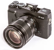 FUJIFILM X-E2 mirrorless camera with FUJINON LENS XF18-55mm F2.8-4 R. Photo of FUJIFILM X-E2 mirrorless camera with FUJINON LENS XF18-55mm F2.8-4 R LM OIS on Royalty Free Stock Photography