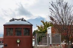 Fujikyu train red car at Kawaguchi station with Fuji mountain in background Stock Images