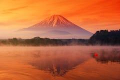 Fujisan and lake Shoji at dawn. Fujisan or Fuji mountain landscape with relfection from Lake Shoji or Shojiko at dawn with twilgiht sky and mist in early morning stock photo