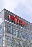 Fujitsu company logo on headquarters building