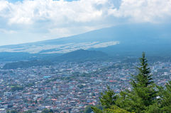 Fujiyoshida city view from above, Yamanashi prefecture, Japan. Fujiyoshida city with foot of Mount Fuji covered in clouds, view from above, Yamanashi prefecture Royalty Free Stock Image