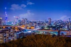 Fukuoka Night Cityscape, Early Spring. Night view of Fukuoka City from Atago Shrine in early spring featuring Fukuoka Tower, Momochi, Ohori Park, the Muromi royalty free stock images