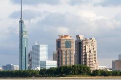 Fukuoka`s Momochi Area with Fukuoka Tower. FUKUOKA, JAPAN - NOVEMBER 19, 2016: Sea view of Fukuoka Tower, office buildings, and apartment buildings of Momochi stock photography