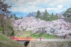 FUKUSHIMA, JAPAN - APR 15,2016:Tsuruga Castle surrounded by hund Stock Photo