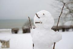 Ful snögubbe Arkivfoto