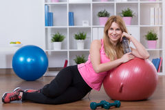 Fulfilled after physical activity. Young woman is very fulfilled after physical activity Royalty Free Stock Photography