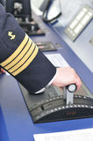 Full ahead !. Navigation officer manages remote control of main engine on the navigation bridge of ocean ship Stock Images