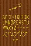 Full alphabet cutout on bark Stock Photos