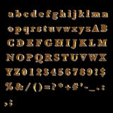 Full Alphabet of rusty yellow painted painted metal. Including lower, upper and specal case Royalty Free Stock Images